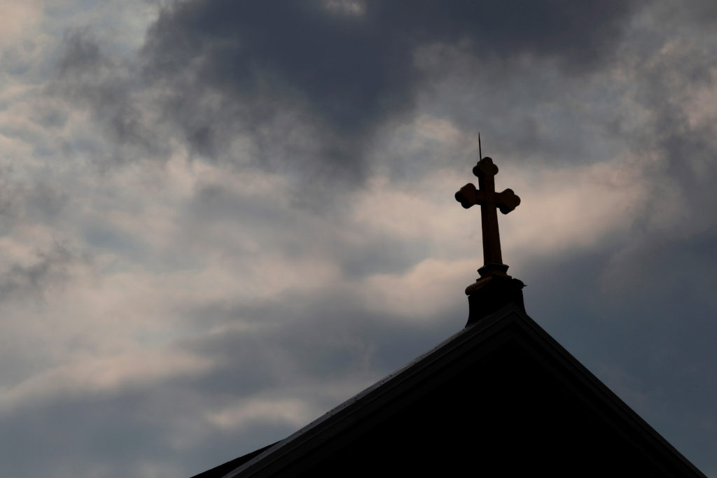FILE PHOTO: Storm clouds pass over a Roman Catholic church in Pittsburgh