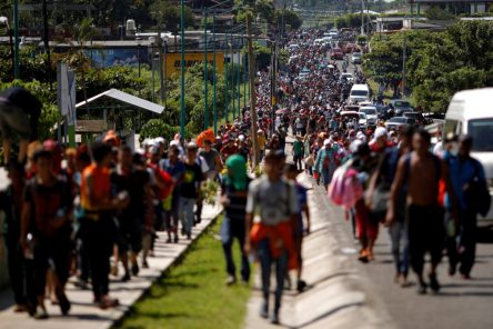 Central American migrants walk along the highway near the border with Guatemala, as they continue their journey trying to reach the U.S., in Tapachula