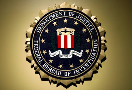 The Federal Bureau of Investigation seal is seen at FBI headquarters before a news conference by the FBI Director the inspector general's report in Washington